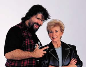 Linda McMahon and a wrestler.
