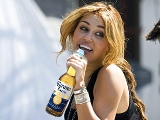 Miley Cyrus Caught Drinking a Beer, Said to be Heading Towards Self Destruction