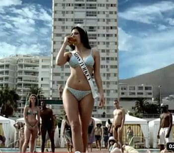 Miss Turkey wants to sell you charbroiled burgers in her new bikini.