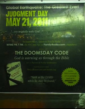 The Doomsday Code as it appears against a NYC bus shelter.