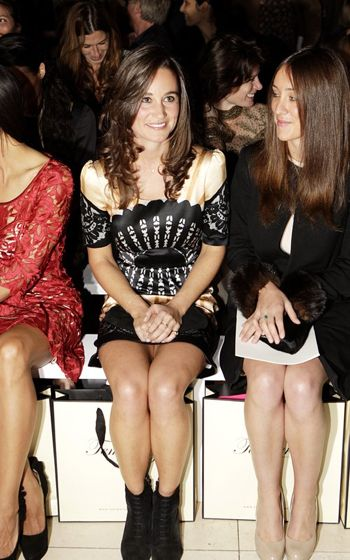Pippa Middleton, hawt bixch takes her rightful place front row at London Fashion Week.