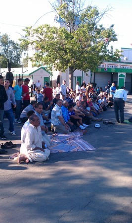 Muslims pray outside Playland after 15 arrested Tuesday. Credit: Renea Henry