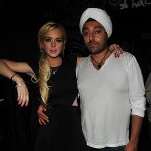 Lindsay Lohan causes a scene as she tells off her millionaire boyfriends model wife.