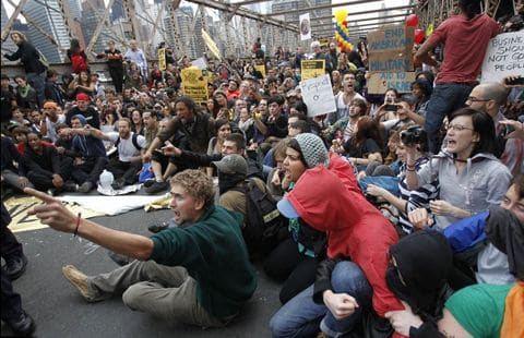 Image sources via dailymail.co.uk via Reuters. Protesters on the Brooklyn Bridge,NYC this weekend past.
