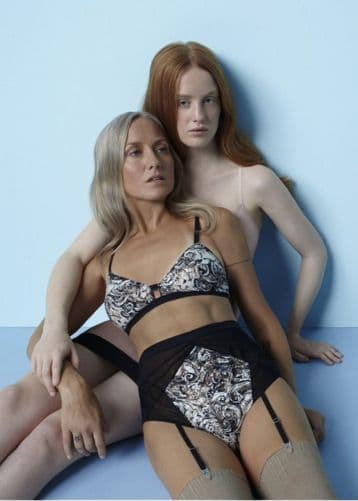 Lingerie ad strikes controversy as mother and daughter are pitted together in garter belts in provocative poses.