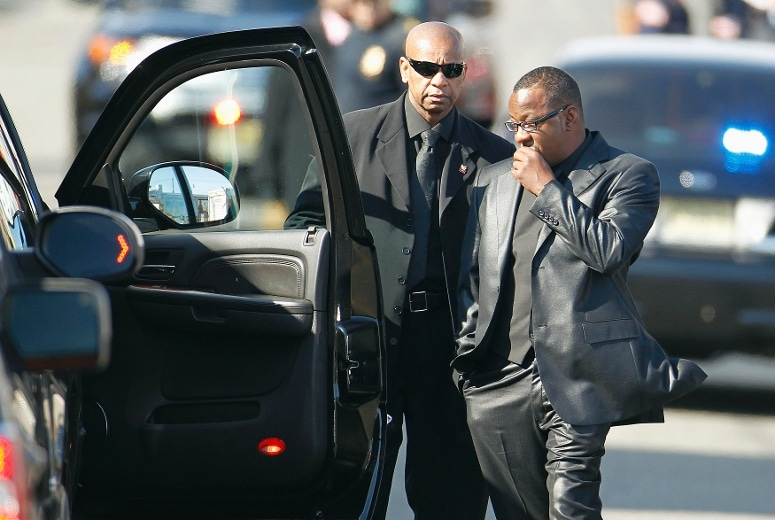 Bobby Brown (R) is denied entrance to the funeral service of ex-wife pop singer Whitney Houston at the New Hope Baptist Church in Newark, New Jersey