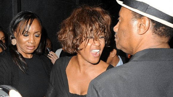 Last public photos of Whitney Houston shows her disheveled, disorientated and very agitated.
