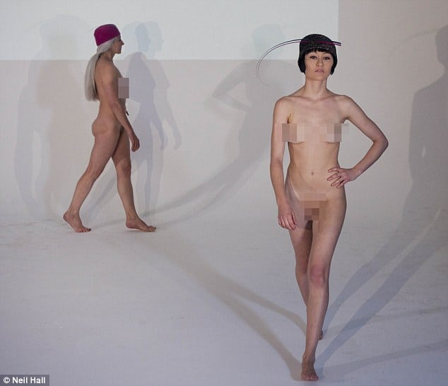 Robyn Coles debut fashion show features striking hats as well as striking naked models.
