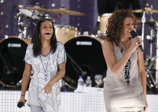 Singer Whitney Houston performs with her daughter, Bobbi Kristina (L), during a taping of Good Morning America on ABC in New York September 1, 2009.  REUTERS/Lucas Jackson (UNITED STATES ENTERTAINMENT)