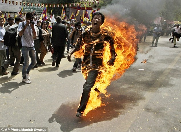 Video: Tibetan protester sets himself on fire ahead of Chinese presidents arrival.