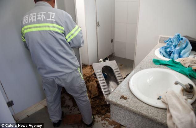 Chinese woman gives birth in toilet, Emergency workers at the scene.