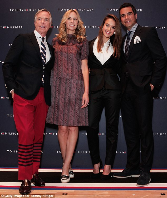 : The designer with (from l-r) wife Dee Hilfiger, Jessica Alba and her husband Cash Warren