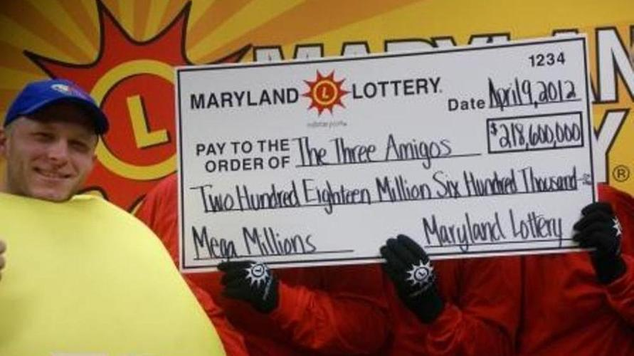 The three anonymous Mega Millions winners celebrate their $218.6 jackpot with a lotto friend