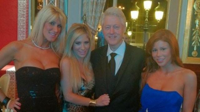Yum Bill Clinton poses with porn stars at Monte Carlo Casino.