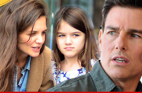 Image via tmz. Katie Holmes, Tom Cruise and their 6 year old daughter, Suri.