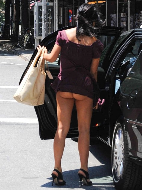 Oops. Here are photos of Alec Baldwins fiance Hilaria Thomas with her crotchless panties as the wind blows.