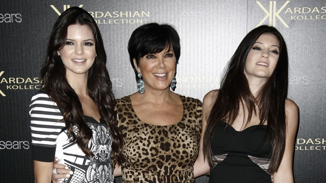Kris Jenner with her 2 little budding media whore junior daughters, Kendall (on the left) and Kylie