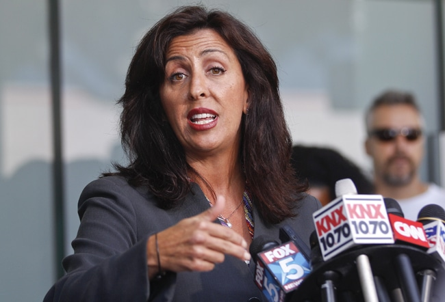 Lisa Damiani, an attorney and spokesperson for the parents of alleged Colorado mass murderer James Holmes, speaks at a news conference, Monday, July 23, 2012 in San Diego. Damiani says Holmes' mother had no idea he was believed to be the gunman who killed a dozen people in a Colorado theater until a reporter contacted her at her San Diego home. (AP Photo/Lenny Ignelzi)