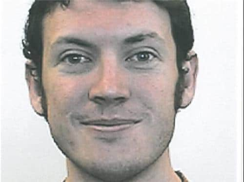 James Holmes described as quiet and easy going.