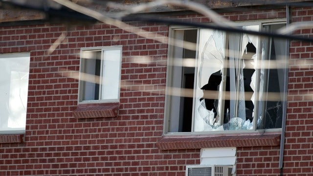 James Holmes' apartment. Broken windows.