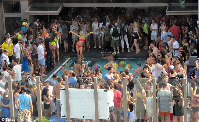 Bikini clad revelers at trendy NY hotel top pool parties driving neighbors mad.