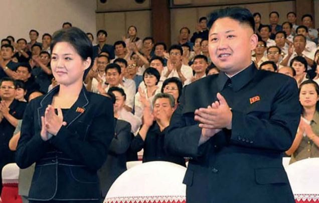In this photo released by the Korean Central News Agency (KCNA) and distributed in Tokyo by the Korea News Service on Monday, July 9, 2012, North Korean leader Kim Jong Un, center right, and a woman clap with others as they watch performance by North Korea's new Moranbong band in Pyongyang, North Korea, Friday, July 6, 2012. The source did not identify the woman but South Korean media speculated that she could be Kimís younger sister or wife. (AP Photo/Korean Central News Agency via Korea News Service)