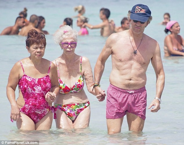 Oh my! 86 year old Duchess of Alba hits the surf with her floral bikini and 61 year old hawt bixch husband.