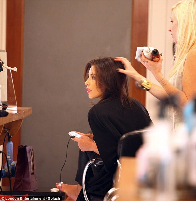 Kim Kardashian likes to indulge herself as she tends to her hair.