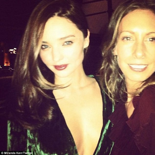 Oh my! More half naked pictures of Miranda Kerr as she slums it in her bikini...