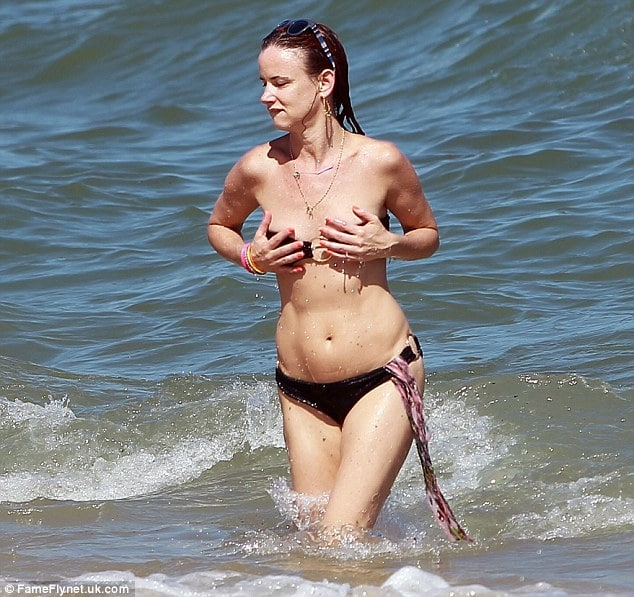 Oh my Juliette Lewis. Don't let the waves take your top...