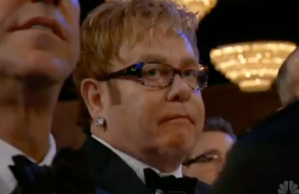 Elton John at this years Global Awards. This is the exact moment Elton barfed in his mouth when Madonna won for best original song