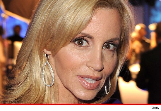 Camille Grammers bikini pictures dont sit too well with ex husband Kelsey.
