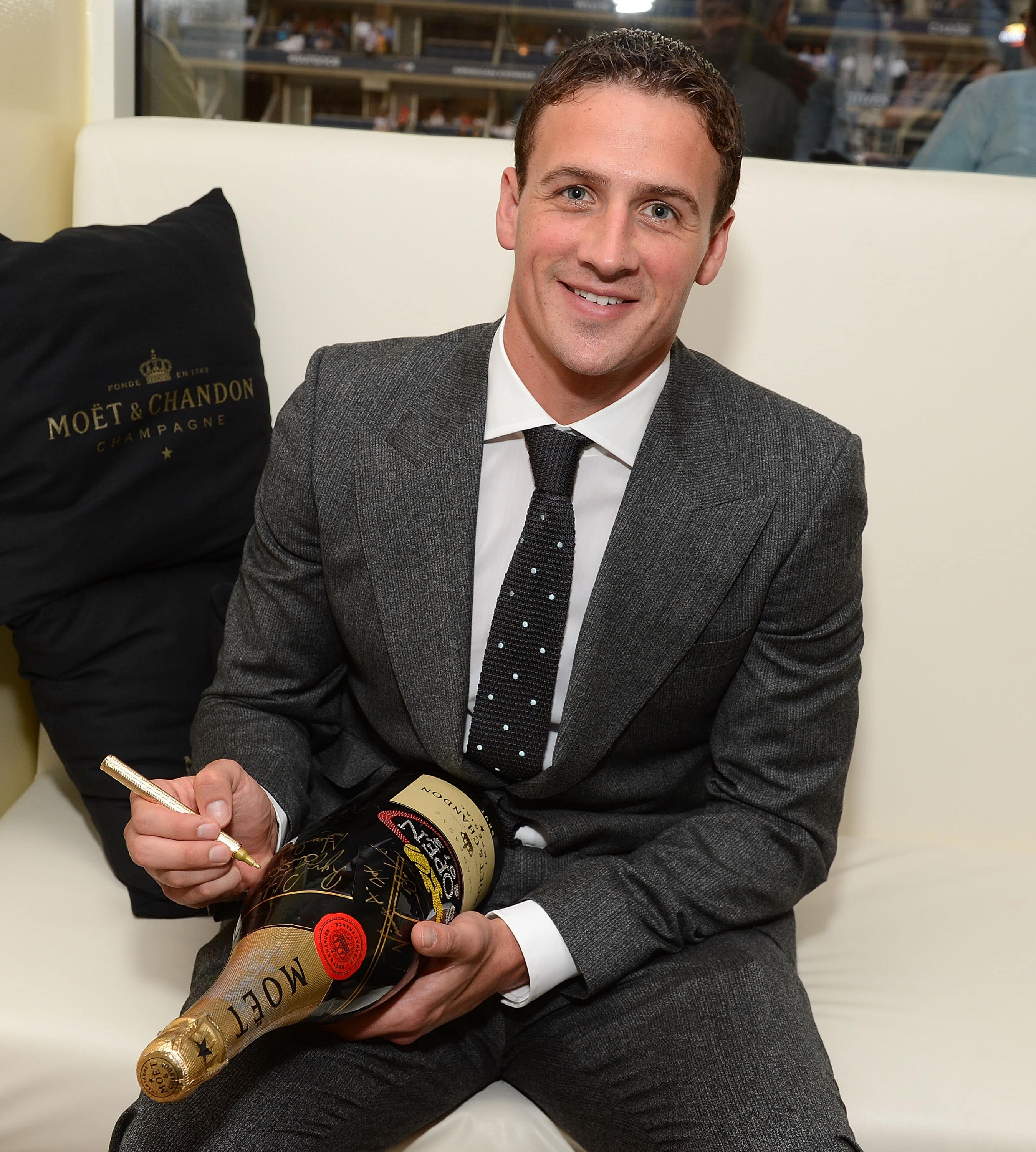 NEW YORK, NY - SEPTEMBER 05:  Swimmer Ryan Lochte visits the Moet & Chandon Suite at the 2012 US Open at the USTA Billie Jean King National Tennis Center on September 5, 2012 in the Flushing neighborhood of the Queens borough of New York City.  (Photo by Michael Kovac/Getty Images for Moet & Chandon)
