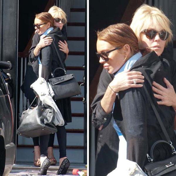 Never mind, Lindsay Lohan and Dina now kiss and make up.