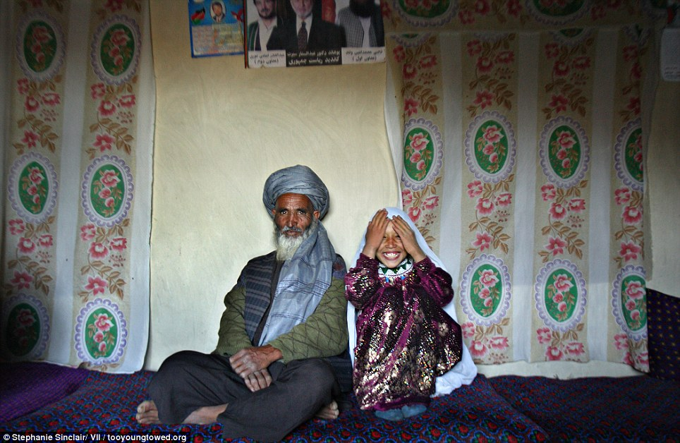 Portrait of Said, 55, and Roshan, 8, on the day of their engagement, Afghanistan