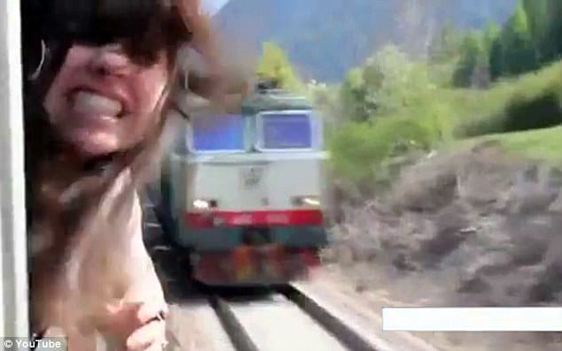 Girl narrowly escapes being decapitated by a speeding train