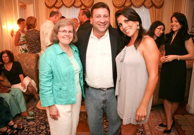 Holly Petraeus (left) with Scott Kelley (center) and Jill Kelley (right) at a party.