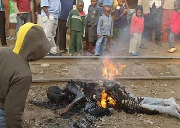 Gay person burned alive by anti gay mob in Uganda.