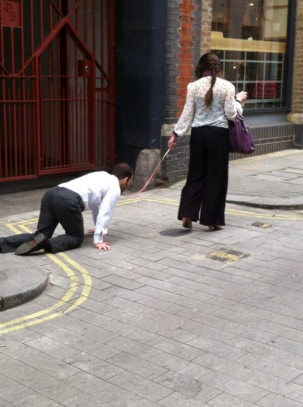 Video: London woman walking man on a leash. Did he lose a bet?