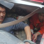 Kong Huang, injured Chinese truck driver calls his wife before agreeing to have his leg amputated.