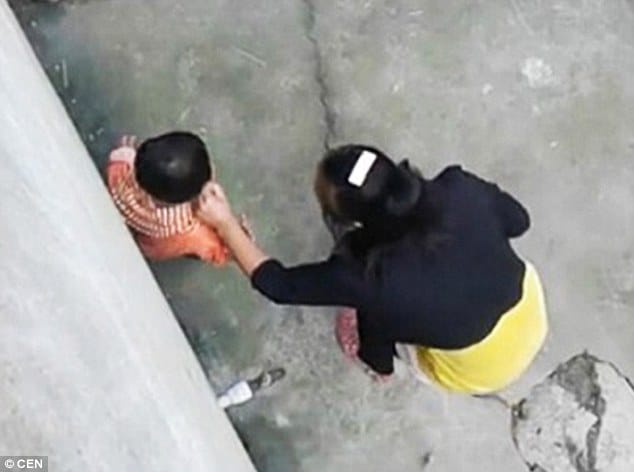 video chinese stepmother whips and kicks toddler for
