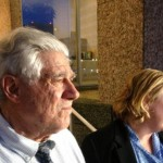 Wayne Burgarello, 74, left, watches as his lawyer, Theresa Ristenpart, talks to reporters Friday night, May 29, 2015, outside the Washoe County Courthouse in Reno, Nev., after a jury found him not guilty of murder and all other charges in the 2014 fatal shooting of an unarmed trespasser at a vacant duplex Burgarello owns in Sparks. (AP Photo/Scott Sonner)