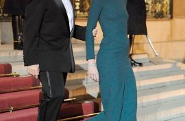 Carla Bruni's tight dress has heads turning.