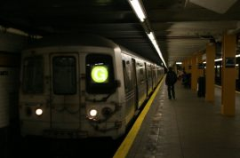 Woman killed by subway train trying to retrieve her purse.