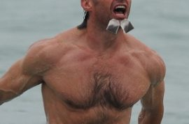Hugh Jackman wants you to guess what he's doing.