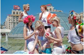 Ukranian Feminists FEMEN stage a strike in an empty faucet.