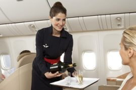 Air France stewardess is arrested for stealing from first class and business class flyers.