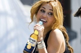 Miley Cyrus Caught Drinking a Beer, Said to be Heading Towards Self-Destruction