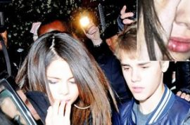 Selena Gomez- punched in the face or drench kissed by Justin Bieber?