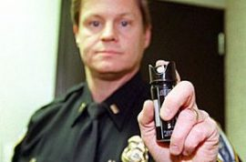 Cops pepper spray stick carrying 8 year old.